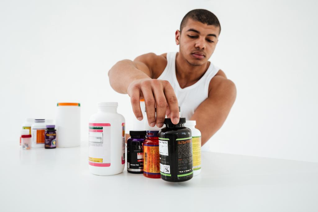 Man checking out Supplement bottles